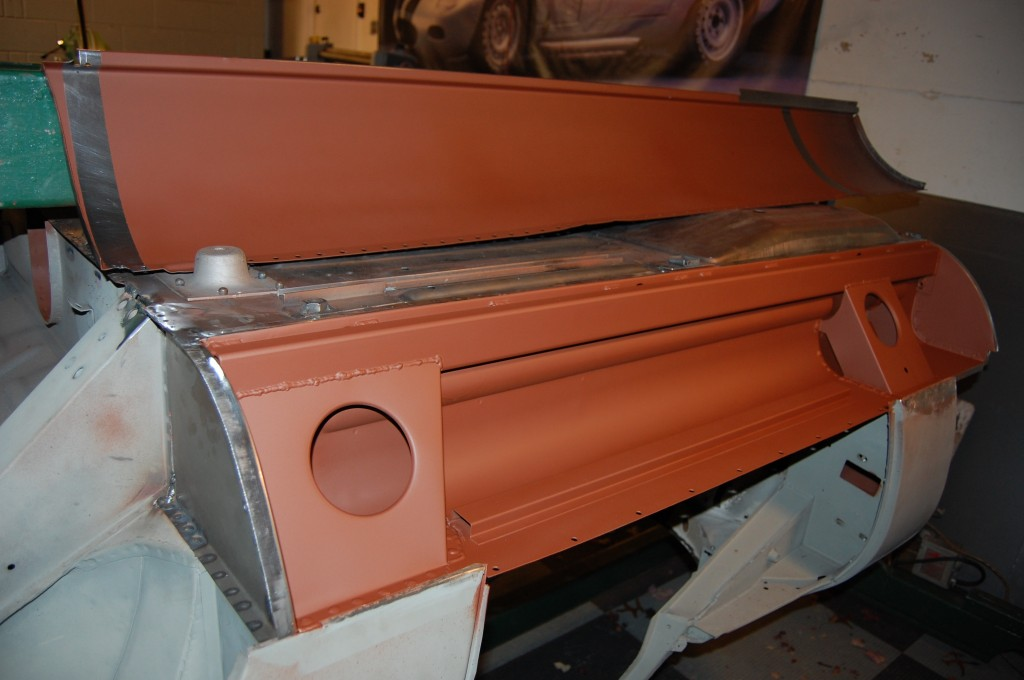 So, we re-arch the sill, AND form a custom rear closing panel to match the final shape - here you can see it already installed on the left end of the photo.  Then everything gets coated with red oxide before being closed up.