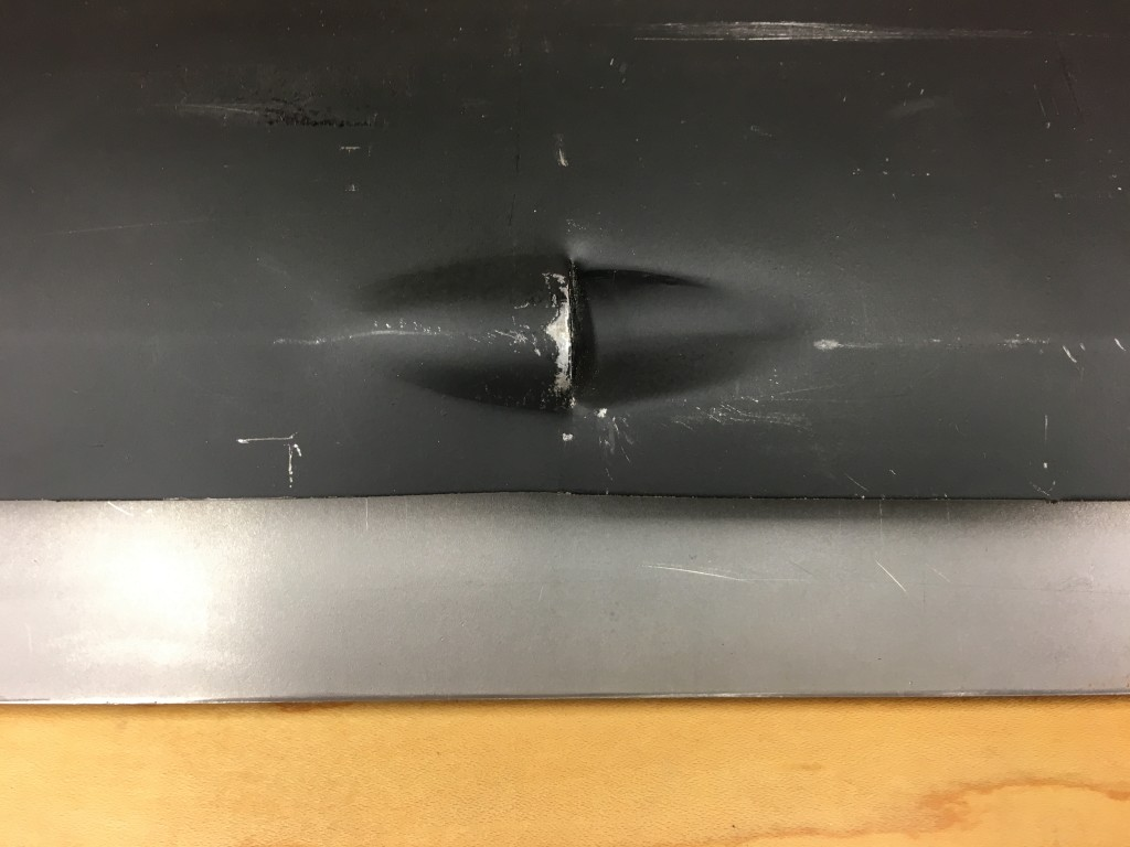 ...which might be why they came up with this strange drain hole arrangement in the forward end of their sills. The inward facing portion of this ALWAYS needs to be mashed flat just to get the sill on, and the purest restoration shops will even hammer and dolly this and weld it shut altogether. The Monocoque Metalworks sills do NOT have this drain - because factory E-Types do not!