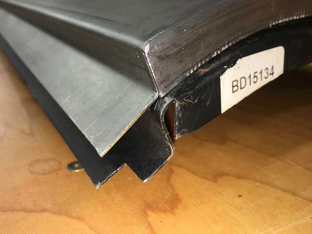 A comparison of the forward, upper corner. The Monocoque Metalworks sill is on top, the other brand available is on bottom - the VERY bottom - well below what is even remotely acceptable I would say... And they ALL look like this - this is not an exception. If your body shop attempts to solve this problem with plastic filler - or even lead - you are going to have BIG problems down the road!